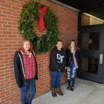 UTC Horticulture students make the holiday wreath for UTC school entrance.